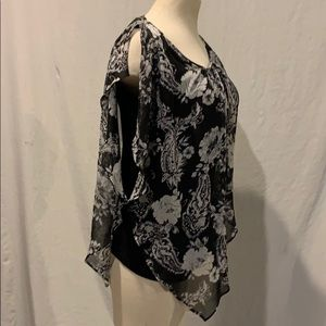 Woman's black and white floral print blousy top